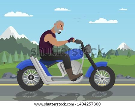 biker riding motorcycle on