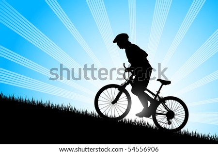 Biker riding up to hill
