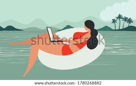bikini woman working on laptop