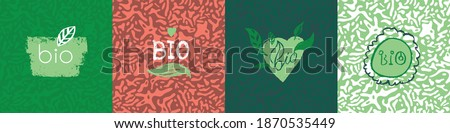 Bio badges set in vector hand drawn style. Insignia collection of Green Thinking symbol. Bio icon set on color abstract pattern. Biological emblem for environment logo concept. Bio-product sign design Foto stock ©