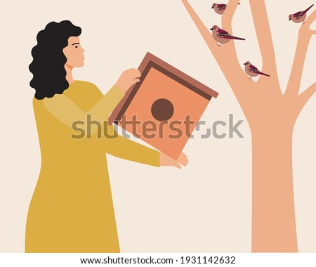 Birdhouse on a tree and a woman. Flat vector stock illustration. The person broadcasts the bird feeder. Caring for nature. Ecology concept. Birds live in a birdhouse ストックフォト ©
