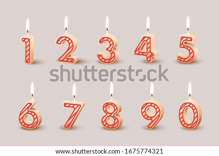 Birthday candles with burning flames isolated on light brown background. Vector design elements Foto stock ©
