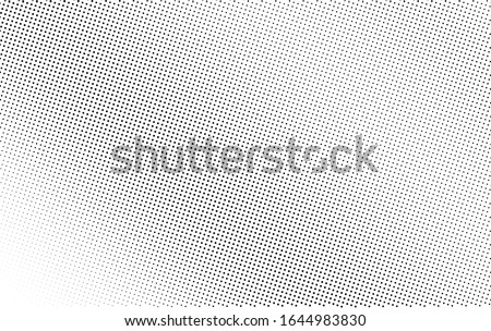 Black and white abstract vector halftone. Frequent half tone shade texture. Retro effect overlay. Diagonal dotted gradient. Dot pattern on transparent backdrop. Industrial halftone perforated texture