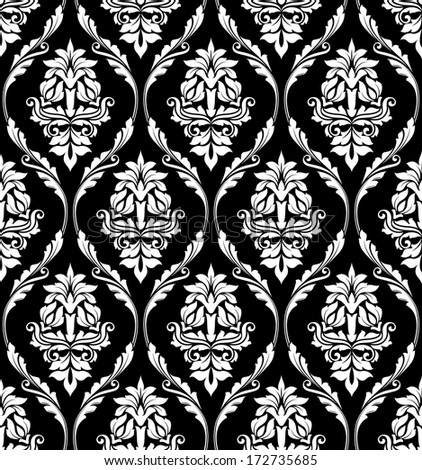 Black and white damask-style design of floral arabesques in a heavy repeat seamless pattern suitable for print and textile