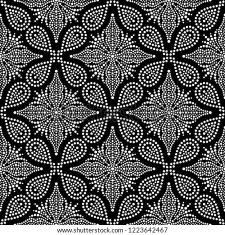 Black and white seamless pattern of dotted flowers, snowflakes, stars in trellis. Mosaic floral print of white dots. Geometric lattice print of beads. Vector Illustration.