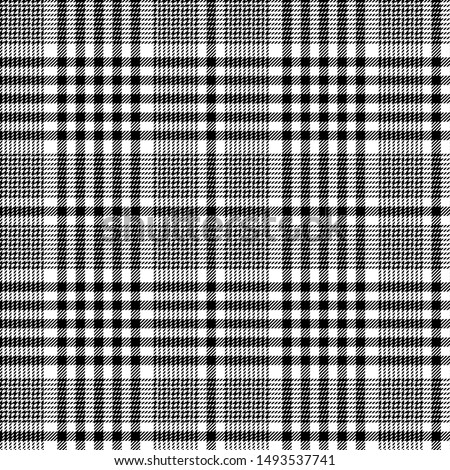 Black and white tartan plaid Scottish seamless pattern.Texture from plaid, tablecloths, clothes, shirts, dresses, jacket, skirt, paper, bedding, blankets and other textile products.Glen plaid
