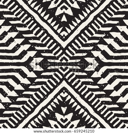 Black and white tribal vector seamless pattern with doodle elements. Aztec abstract geometric art print. Ethnic ornamental hand drawn backdrop. - Shutterstock ID 659245210