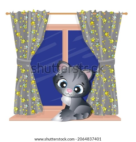 Black cute kitten sits on the night window.