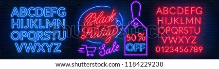 Black Friday neon lettering on brick wall background with the alphabet