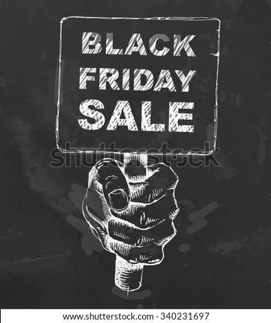Black friday Sale on blackboard. Sketched hand holding card. Vector illustration