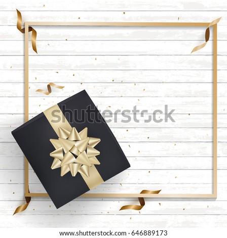 black gift box and gold bow