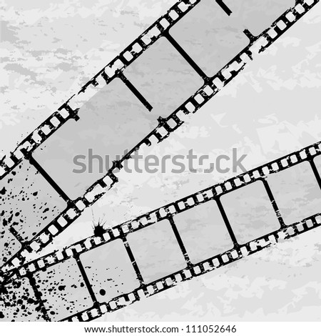 Black grunge background with film and ink blots
