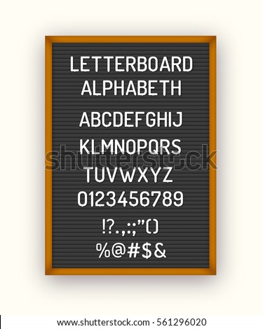 Black letterboard with white plastic letters, numbers, symbols. Hipster vintage alphabeth 80x, 90x