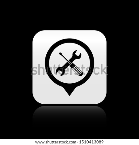 Black Location with crossed screwdriver and wrench tools icon isolated on black background. Pointer settings symbol. Silver square button. Vector Illustration