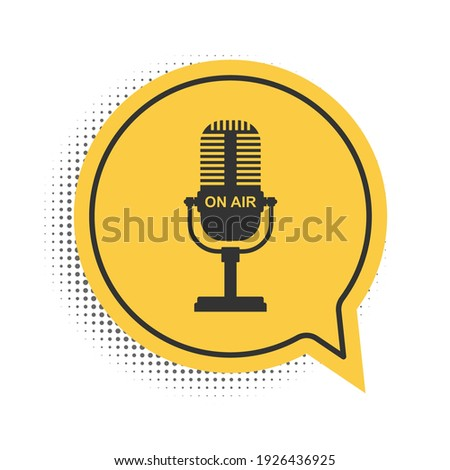 Black Microphone icon isolated on white background. On air radio mic microphone. Speaker sign. Yellow speech bubble symbol. Vector ストックフォト ©