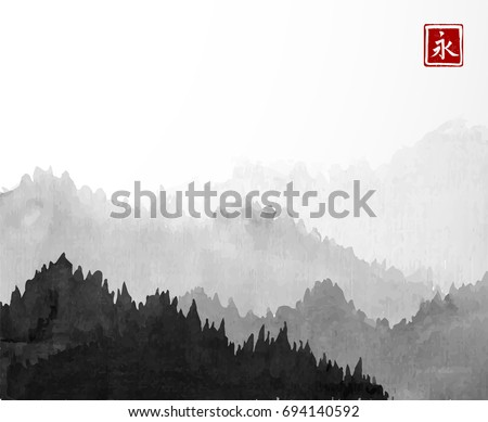 black mountains with forest