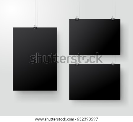 black poster hanging on binder