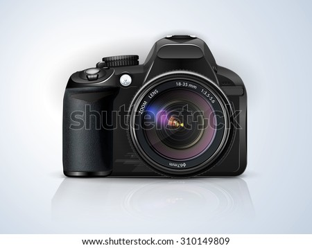 black professional SLR camera on a grey background with the reflection of the