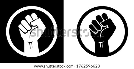 Black raised fist protest symbol icons. Clenched fist with circle isolated on black and white backgrounds. Justice, solidarity, anti-racism and strength gesture icon set. Emancipation and freedom.