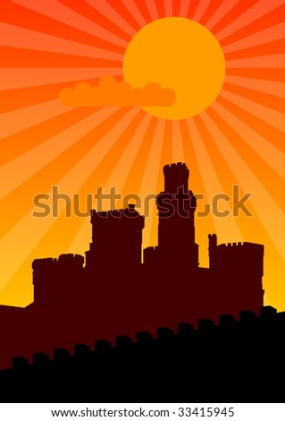 Black silhouette of old castle on the orange sunset.