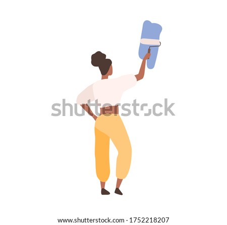 Black skin female professional painter painting on wall holding paint roller vector flat illustration. Back view creative woman decorator writing advertising text isolated on white background Foto stock ©