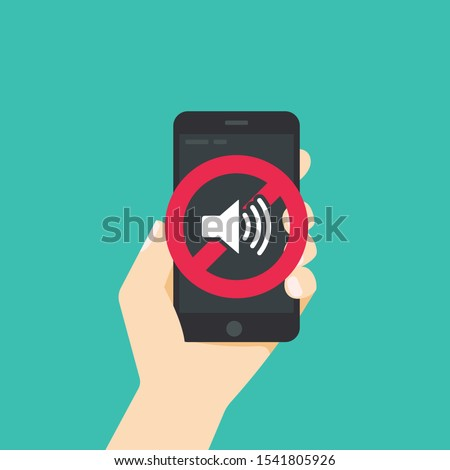 Black smartphone with mute or silent mode symbols on white screen isolated on green background. Сток-фото ©
