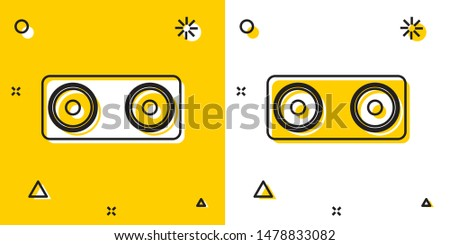 Black Stereo speaker icon isolated on yellow and white background. Sound system speakers. Music icon. Musical column speaker bass equipment. Random dynamic shapes. Vector Illustration stock photo