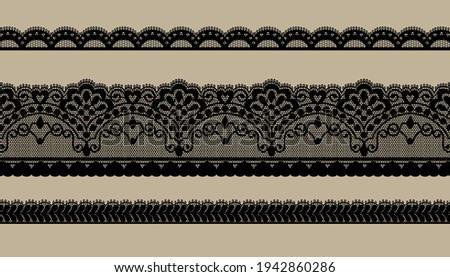 Black Trim Lace Ribbon on brown background.Jacquard Mesh Lace Fabric. ストックフォト ©