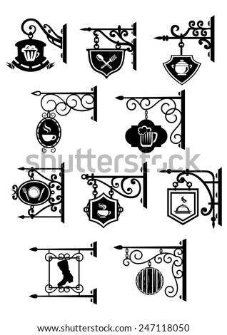 Black vintage street signboards hanging on forged brackets with symbols of bar, pub, cafe, restaurant and workshop