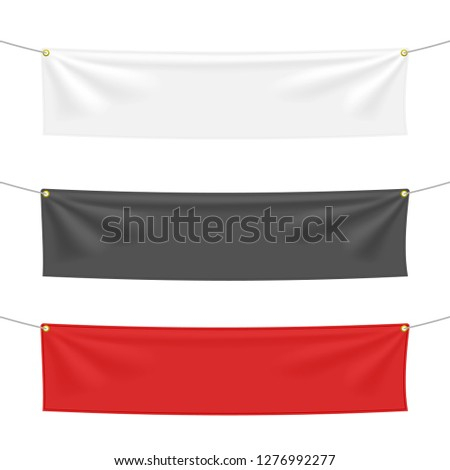 Black, white and red textile banners with folds