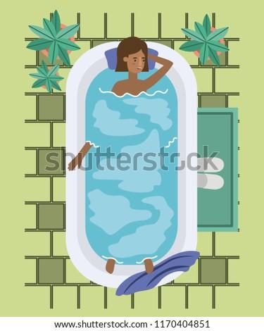 black woman taking a bath tub