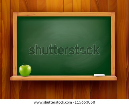 blackboard with green apple on