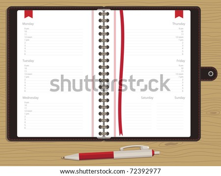 blank appointment book with week days and pen on wood background
