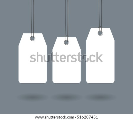 Blank dangling paper label or cloth tag set isolated on dark gray background. Sale tags for promo design and advertising