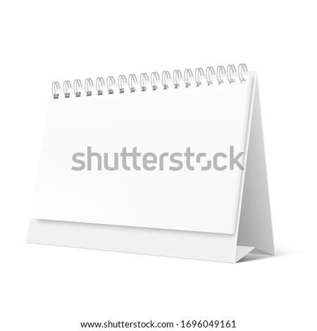 Blank desktop calendar isolated on white background. Blank desktop spiral calendar. Realistic white blank standing desk calendar with a spiral