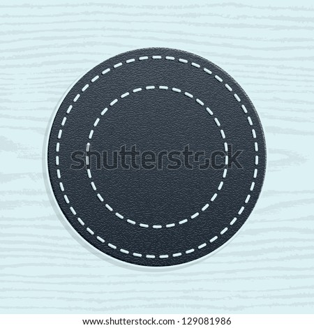 Blank leather badge in retro vintage style. Template Premium Quality and Satisfaction Guaranteed labels. Circle shape on wood texture pattern background. Vector illustration web design element 10 eps