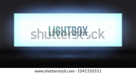 Blank lightbox in the dark. Illuminated lightbox screen with empty space for design. Blank billboard or white LCD display screen.