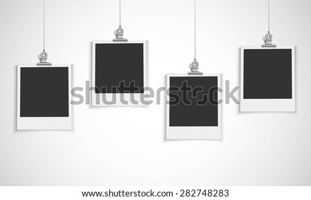 Blank photo frame hanging on a line with bulldog clip
