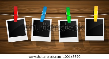 Blank photo frames on a clothesline. Vector illustration.