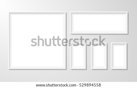 blank picture frame template set isolated on wall. Set of white photo frames. Vector realistic white picture frame composition. Modern design element for you product mock-up or presentation. #529894558