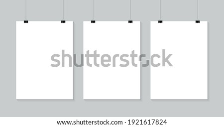 Blank posters hanging on a binder clips. A4 white paper sheet hangs on a rope with clips. Mock up banner for promotion and advertising. Vector illustration.