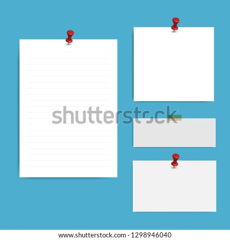 Blank squared notepad pages and pin. Note paper stuck with red pin.