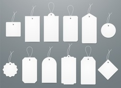Blank white paper price tags or gift tags in different shapes. Set of labels with cord.