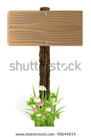 Blank wooden sign board with grass