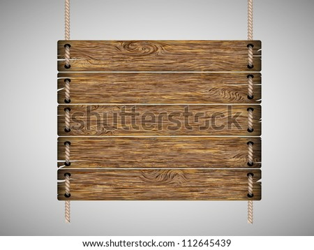 blank wooden sign hanging on a rope. isolated on white background