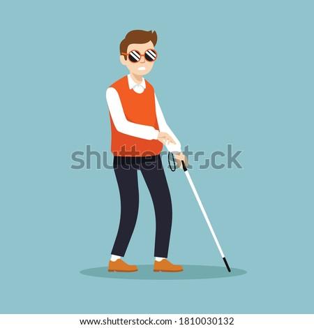 blind man walking with stick