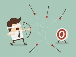 Blindfold businessman shooting arrow