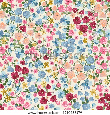 Blooming midsummer meadow seamless pattern. Plant background for fashion, wallpapers, print. A lot of different flowers on the field. Liberty style millefleurs. Trendy floral design