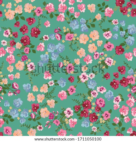 Blooming midsummer meadow seamless pattern. Plant background for fashion, wallpapers, print. A lot of different flowers on the field. Liberty style millefleurs. Trendy floral design stock photo