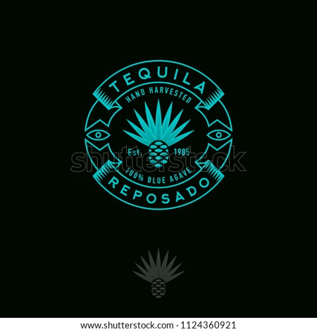Blue agave icon. Tequila or mescal logo. Emblem for the label. Engraving style Agave icon with letters and ribbons on a dark background.